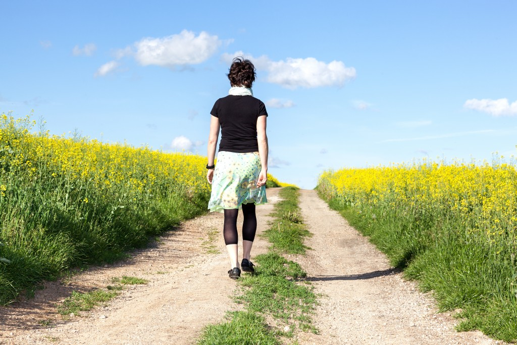 Single woman walking at the farm