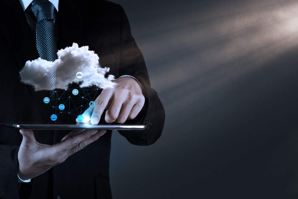 man touching tablet cloud concept